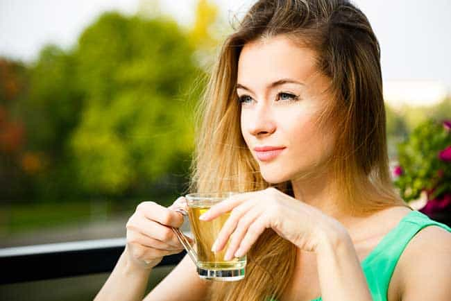 woman drinking green tea for losing weight