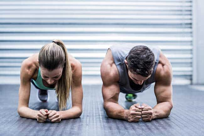 man and woman doing the plank