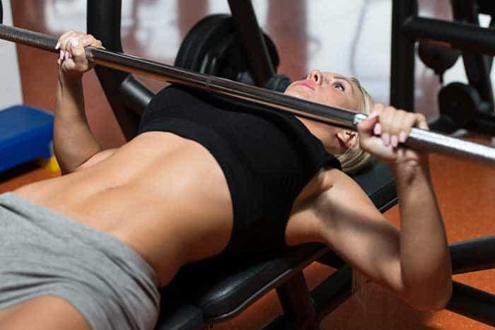 woman bench pressing
